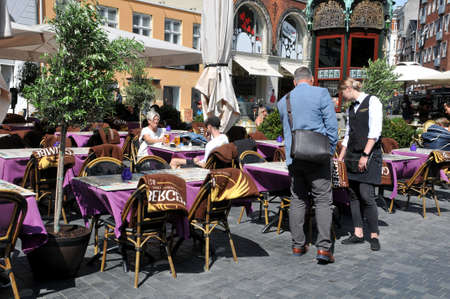 Copenhagen,Denmark, 04Jun.2020/Danes enjoy hot summer day in cafes and restaurants and nalso enjoy day on water by sailing with boats in Christianhavn canal dueint corona virus pandemic /covid-19 in Denmark Editorial