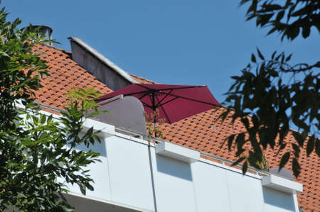 Copenhagen,Denmark, 15.June .2020/Danes use balconies to enjoy summer day with umbrellas for saher adn flowers for little gardening on thier balconies .during covid-19. Editorial