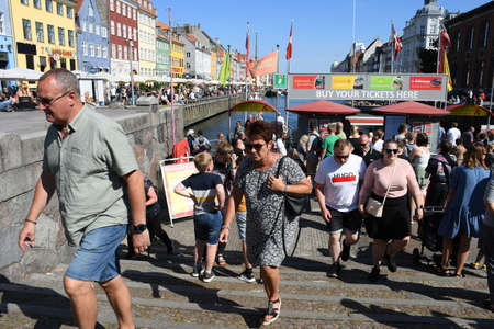 17.July.2020/Tourists are pouring to  Denmark this is view from city is most famous Nyhavn canal boat cruising and cafes  and  restaurants for food and drink on tourists enjoy summer day with danish  food cuisins  and drinks wine and danish popular beer a