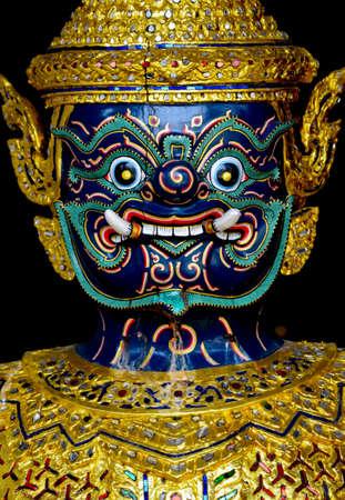 close up of  asurapaksri face a half bird half demon creature decorated on thai royal barge photo