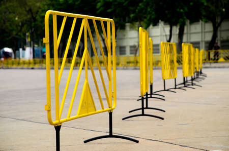 yellow metallic security barrier on the road