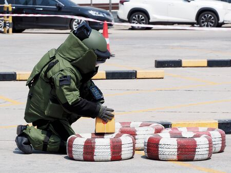 Bomb Disposal Expert in Bomb suit for Explosive ordnance disposal