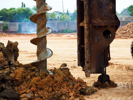 holes boring in ground with drilling rig machine 写真素材