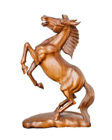 Beautiful sculpture of horse made of only one peace of wood photo