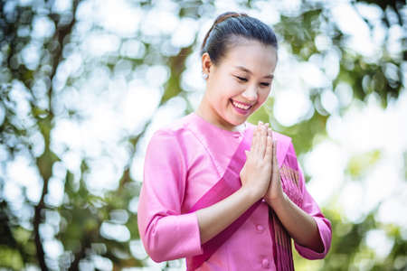 beautiful asian woman with welcome expression  photo