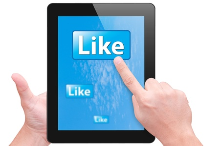 dictatorial: hand point to like button on touch pad