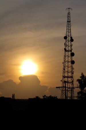 radio tower before sun set photo
