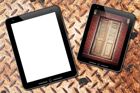 dictatorial: touch pad with old door background and : grunge rusty plate  Stock Photo