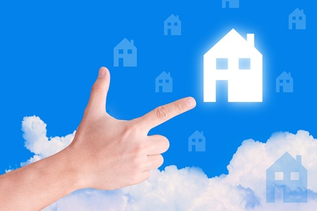 hand take house icon on the sky  photo