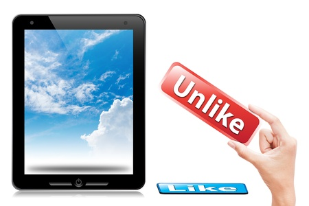 unlike: hand take unlike button to touch pad and sky background