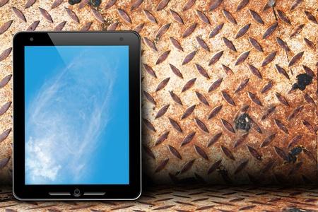 Touch pad on grunge rusty iron diamond steel  photo