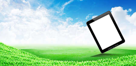 Grass field and cloudy sky background : touch pad space photo