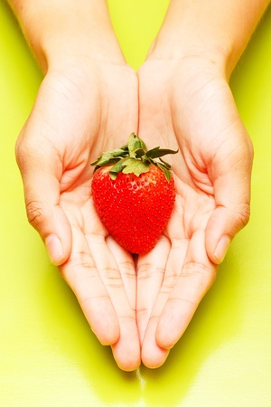 strawberry on Women Hands  photo