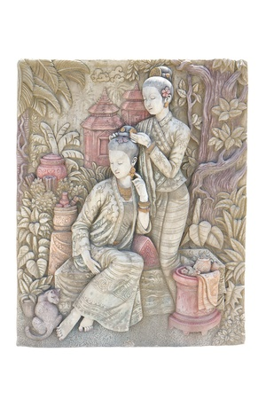 asian angel: Engraving two lady on stone wall - isolated