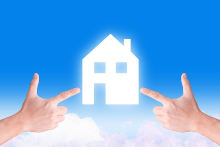 hand point to house icon on the sky  photo