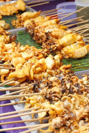 squid stick on grill photo