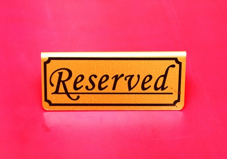 Reserved sign on the table Stock Photo - 10322236