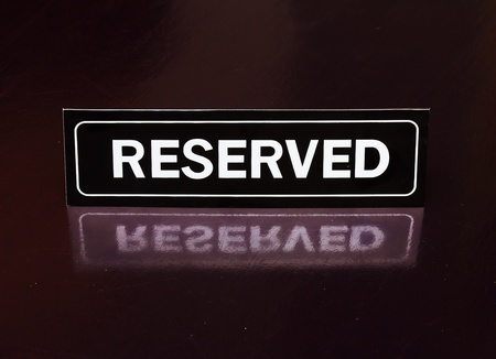reserved: Reserved sign on the table