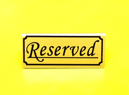 Reserved sign on the table  Stock Photo - 10322219