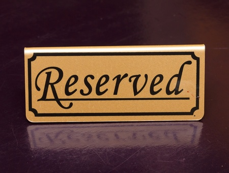 private information: Reserved sign on the table