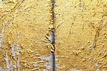 crack gold plate on wood photo