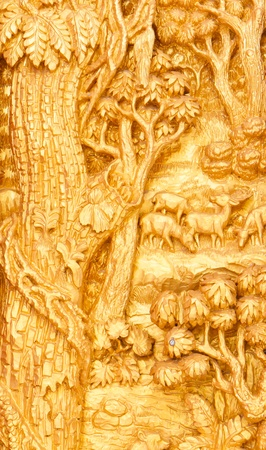 An ancient mural wood carving from Thailand.  photo