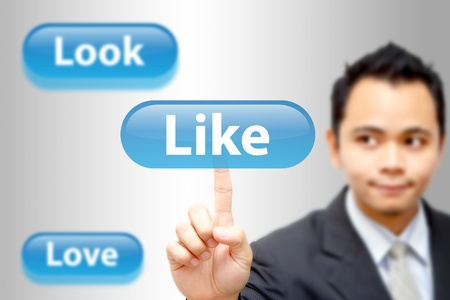 Business man point to like button Stock Photo - 11123010