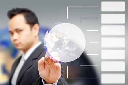 Business man pressing white button Stock Photo - 11123028