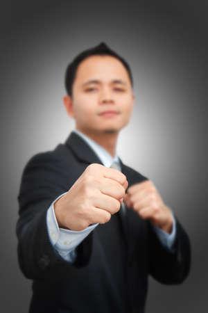 Business man fighting photo