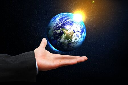 Business man hold the earth on the hand photo
