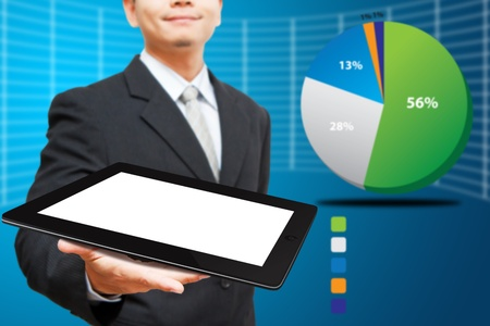 Business man hold the taplet computer and pie chart background photo