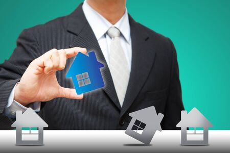 Business man hold the house icon  photo