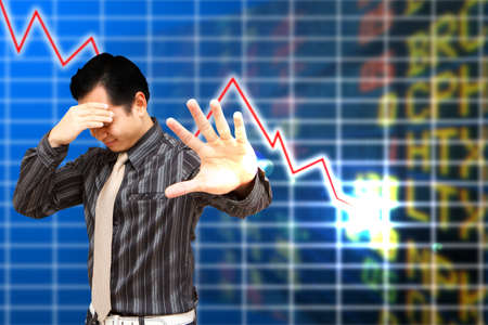 no idea: Headache Business man with low stock exchange graph  Stock Photo