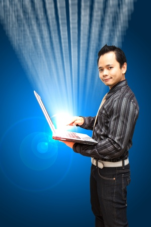 Smile Business man hold Notebook computer with digital background  photo