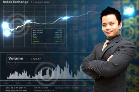 Smile Business man cross ones arm on stock exchange report graph  photo