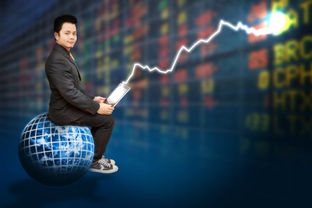 Business man on digital world and stock exchange graph report Stock Photo - 12049666