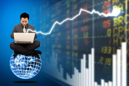 Business man on digital world and stock exchange graph report  photo