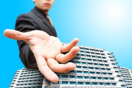 Business man give the hand on building  Stock Photo - 12048585