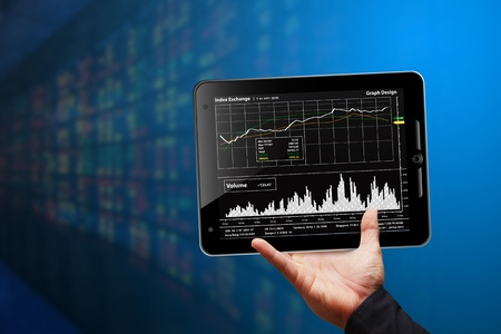 Business man hold Tablet computer and graph report Stock Photo - 12048690