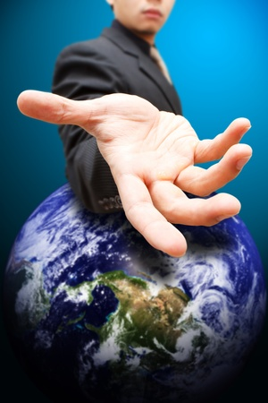 Business man give the hand to globe Stock Photo - 12048727