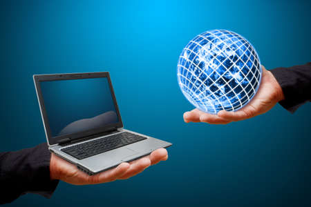 Business man hold notebook  computer and globe  photo