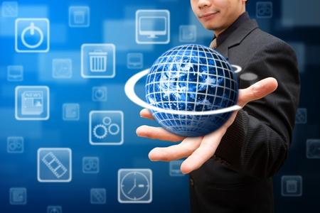 Globe on the Smart hand  Standard-Bild