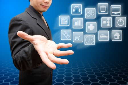 Business man hold many icon Stock Photo - 12048844