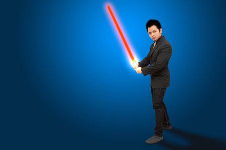 laser light: Smart business man hold The laser sword
