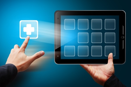 medical emergency service: Smart Hand touch the first aid icon from tablet pc Stock Photo
