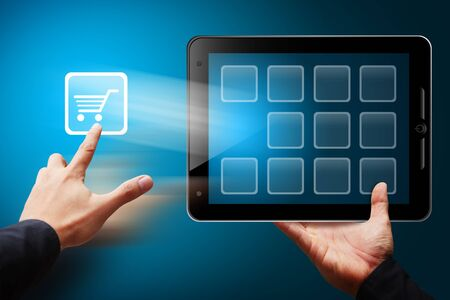 Smart Hand touch the cart icon from tablet pc Stock Photo - 12425189