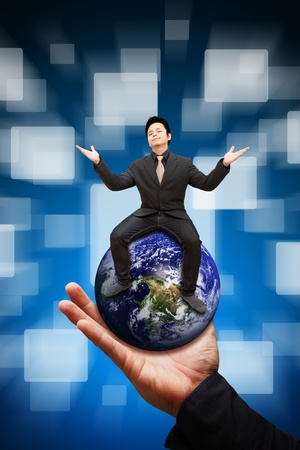 Business man on globe photo