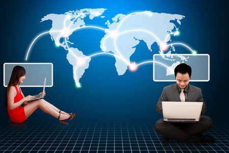 Business man and woman in red dress on world map background photo