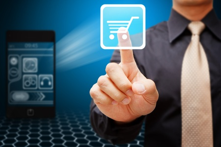 tablet pc in hand: Smart hand touch cart icon from mobile phone