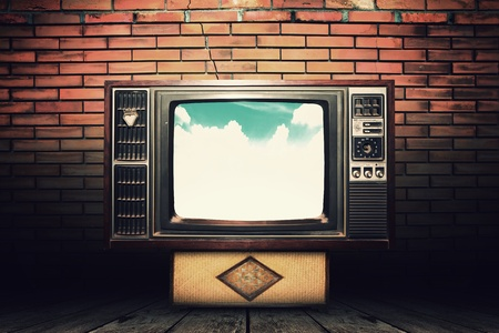 Old vintage TV in the Vintage wooden room on table with sky view  photo